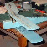 Testing fit and position of top wing prior to gluing it to the cabanes