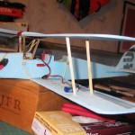 Port wing struts in place