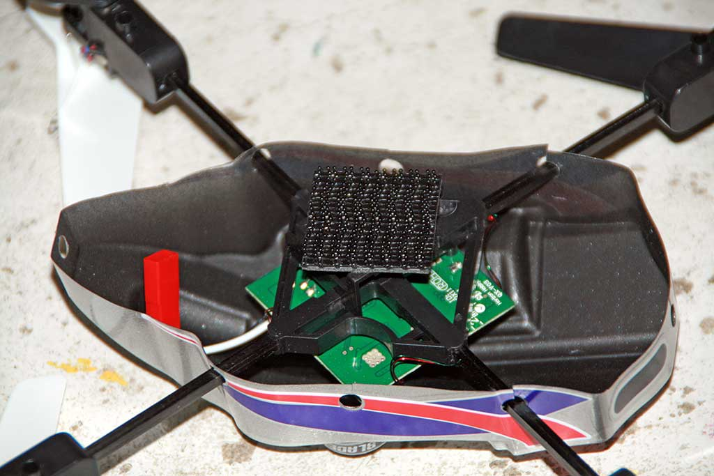 mQX: heavy duty velcro mount under battery compartment