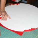 Applying red packing tape
