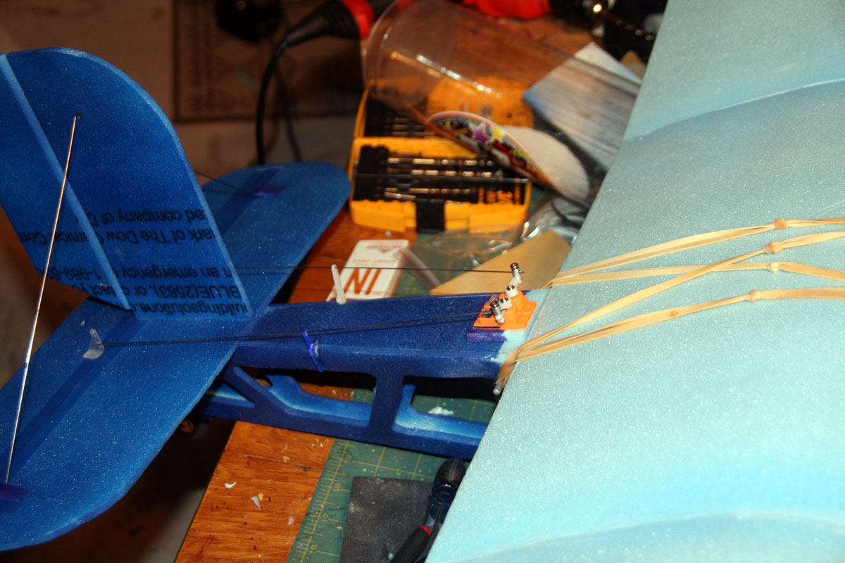 The servos sit on top, right behind the wing
