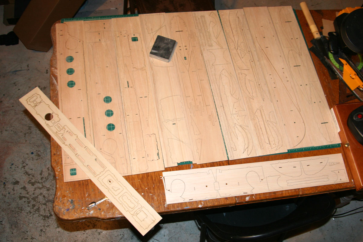 All the wooden parts laid out for a light sanding, per instructions.